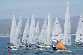 Howth's Aoife Hopkins (205770) arrives into the weather mark on port tack in race three of the Laser Worlds in Mexico, neck and neck with Dutch star Marit Boumeeester in 206333