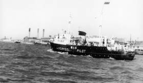 Former pilot station ship Edmund Gardner off Liverpool's old landing stage 1950s-60s. Tours of the vessel are part of the In Safe Hands Exhibition.