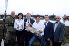 Jim Kennedy of Atlantic Sea Kayaks, Monica Buckley and Peter Shanahan of The Fresh Fish Deli in Rosscarbery, Marine Minister Michael Creed, BIM chief Jim O'Toole and Finian O'Sullivan, chair of FLAG South pictured at Ballycotton Harbour at the announcement of a €3.6 million Fisheries Local Area Action Group (FLAG) fund for Ireland's seven coastal regions