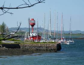 The distinctive Down Cruising Club headquarters in the 102-year-old former lightship Petrel at Ballydorn in Strangford Lough, with the famous Scrabo Tower in the distance beyond. But is Scrabo as high as officially stated?