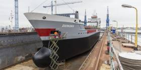 An Irish managed cargoship, Ziltborg that is owned by Dutch owners is seen at their headquarters homeport of Delfzijl where the vessel is in a floating dry-dock. Such a structure was a feature of Cork Dockyard where currently an unconventional busy marine engineering scene is underway as giant ship-to-shore container cranes are to be loaded onto a heavy-lift ship bound for Puerto Rico in the Caribbean.