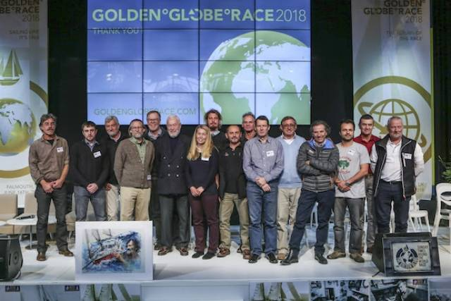 At the Golden Globe Race Press conference at the Paris Nautique Exhibition. Golden Globe Race skippers attending the Presentation on stage: Left to right: Loïc Lepage (60) France, Gregor McGuckin (30) Ireland, Jean-Luc van den Heede (71) France, Carl Huber (56) USA, Mark Sinclair (58) Australia, Sir Robin Knox-Johnston (UK) winner of the first Sunday Times Golden Globe Race in 1968/9, Susie Goodall (27) UK, Nérée Cornuz (27 Switzerland, Lionel Regnier (57) France, Antoine Cousot (45) France, Patrick Phelipon (63) France, Nabil Amra (41) Palestine, Istvan Kopar (63) USA, Are Wiig (57) Norway.