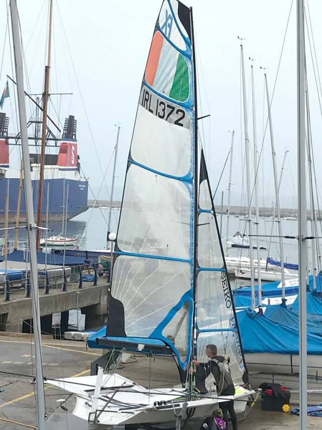 Annalise Murphy's coach Rory Fitzpatrick rigs a women's 49erFX Olympic skiff dinghy at the National Yacht Club in Dun Laoghaire today