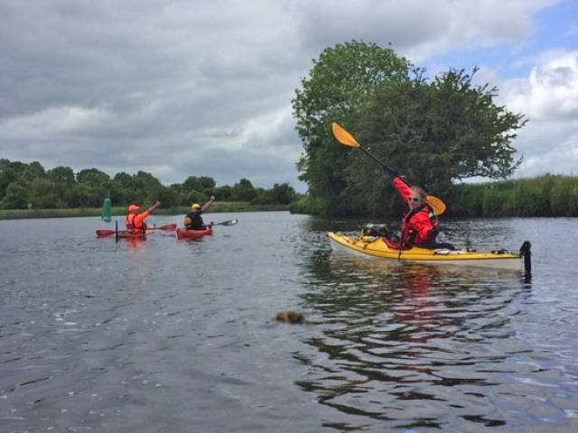 Ger Harrington, Peter Brewitt and James Lynch paddle on the Shannon