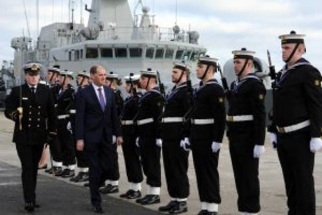 Minister Paul Kehoe inspects a Naval Service guard of honour during the new Defence Forces medal award ceremony held in Dun Laoghaire Harbour at the weekend.