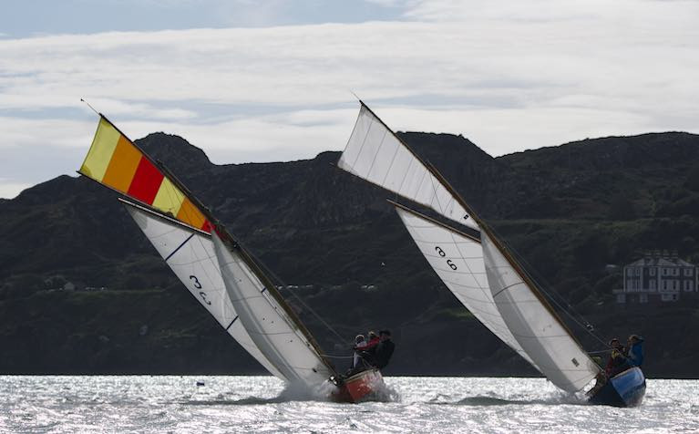 A fair tide with a soldier's wind for Lambay – Roddy Cooper's Leila (built Carrickfergus 1898) and Anita (D.O'Connell & M. Karasahin, built Kingstown 1900 and re-built France 2019) at the start of the Howth 17's Lambay Race