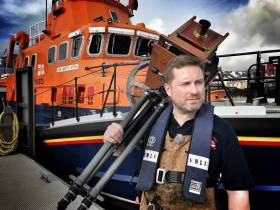 Jack Lowe and camera alongside Castletownbere's all-weather lifeboat Annette Hutton