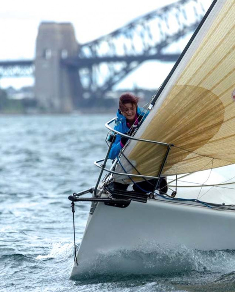 Kinsale meets the famous Harbour Bridge. Stephanie Lyons busy on the bow of the successful Sydney 38 Wild One