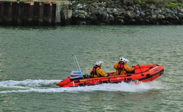 The Wicklow RNLI inshore lifeboat launches to assist the broken-down personal water craft