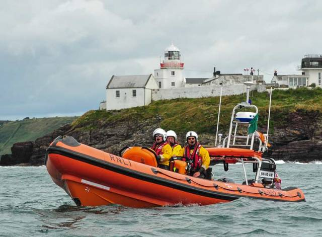 Crosshaven RNLI (above) rescued sailors from upturned boat