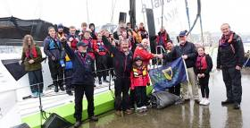 Pierce Purcell (right), Vice Commodore Cruising Association of Ireland, making the presentation to the First Port of Galway Sea Scouts leaders with (left to right) Steve Talbot, Denis Murphy , Margaret Hodkins, Kieran Oliver and Alan Delaunty beside Kilcullen Voyager, cheered on by skipper Enda O'Coineen (centre) and the young sailors.