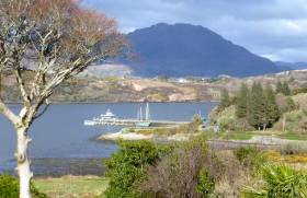 After the longest winter in memory, Spring comes slowly to Connemara, and a new boat is berthed at Letterfrack Pier. Photo: W M Nixon