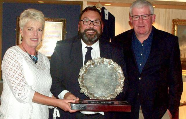 Denis Murphy (right) and Ann Marie Murphy of Nieulargo are presented with the RCYC Boat of the Year award by RCYC Vice Admiral Colin Morehead