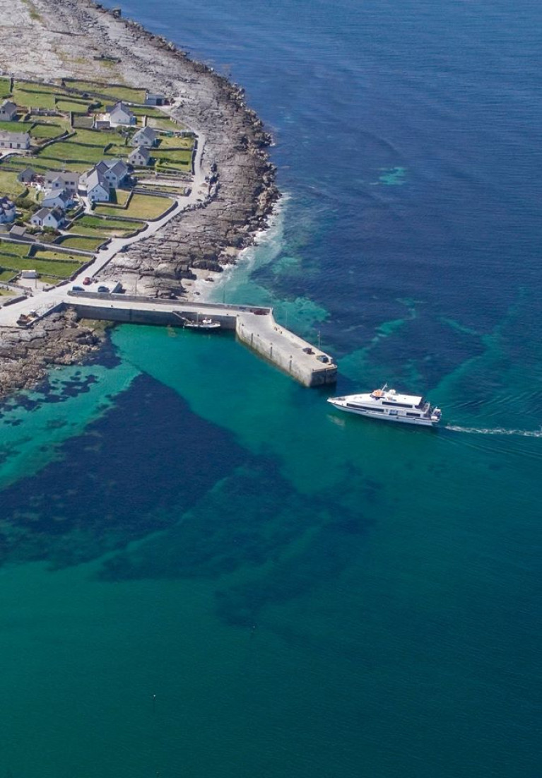 A passenger ferry approaches one of the Aran Islands offshore of the west coast of Ireland