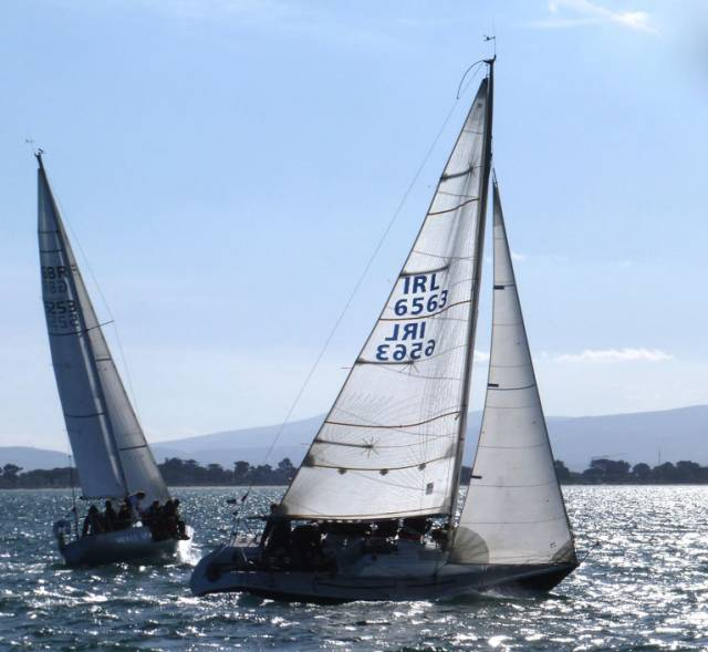 Silver sun, shining sea – Conor Fogerty's historic Silver Shamrock (1976 World Half Ton Champion) and the Formula 28 Animal (G. O'Sullivan) cross tacks in perfect Autumn racing conditions at Howth