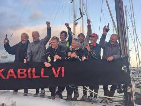 Rockabill VI's crew celebrate their D2D line honours in Dingle this evening. The winning Royal Irish YC crew were (back row) Peter Wilson, Paul O'Higgins, Conor O'Higgins, Rees Kavanagh, Ian O'Meara, Mark Pettit (front row) William Byrne and Ian Heffernan