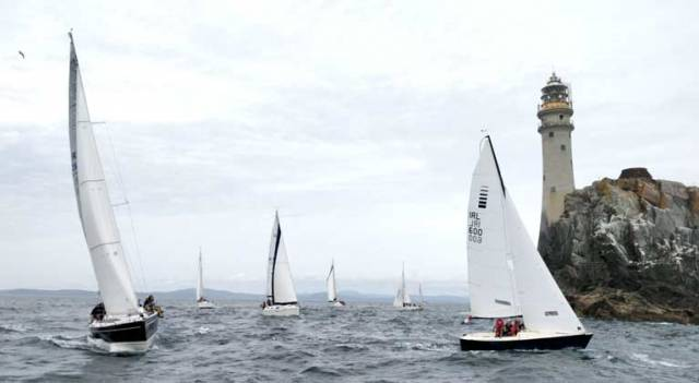 Calves Week competitors arrive at the Fastnet Rock