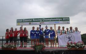 Senior Women's winners Killorglin celebrate, with silver medallists Kilmacsimon (left) and Galley Flash, bronze.