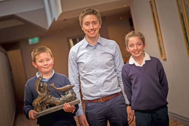 Teacher Adrian Ormsby with pupils Mark Dunleavy and Fiona Whitehead from the senior class at Scoil Chroí Naofa in Bunninadden, Co Sligo and their Something Fishy Award
