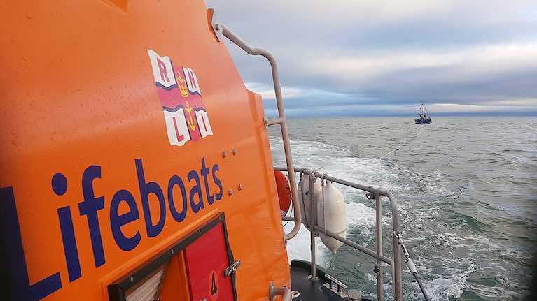 Wicklow RNLI all-weather lifeboat towing the fishing vessel into Wicklow harbour
