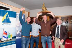 Paul Smith President Mermaid Sailing Association with the 2019 Mermaid Champions, the Foynes Yacht Club triplets Darragh, Noel and Mark McCormack