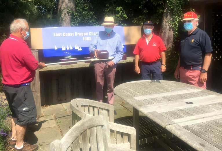 35 years later: (from left) Michael Cotter deploys a two metre paddle to belatedly present prizes to John Kidney, Dan O'Connor and Ailbe Millerick (representing the Grays) for the 1985 Dragon East Coast Championships held in COVID times this week