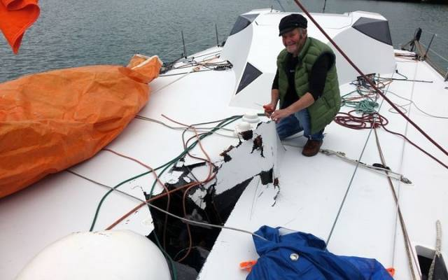 Yachtsman Enda O'Coineen with the damage to his yacht, the Kilcullen Voyager