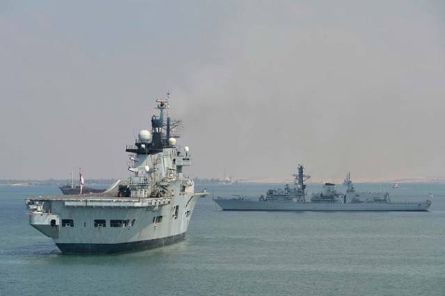 A previous visitor to Dublin Port the former aircraft carrier HMS Invincible which was scrapped last year is seen at anchor in the Suez Canal. Also at anchorage is the Duke Type 23 frigate HMS Westminster which is visiting Dublin this weekend.