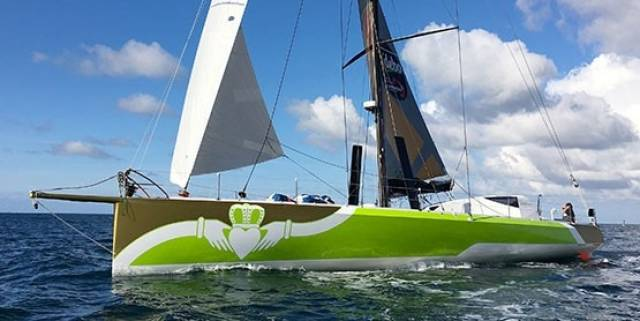 Enda O'Coineen's IMOCA 60 arriving in Kinsale this past August fresh from its refit in France with new race livery