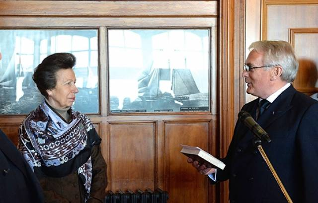 The magic book. The Princess Royal receiving the special copy of Lord Dufferin's Letters from High Latitudes from Myles Lindsay, Vice Commodore, at the recent reception in the Royal Ulster YC