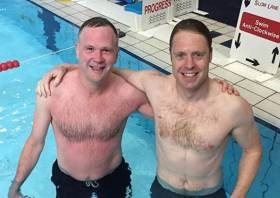 Guy O'Leary (right) after his swim with fellow cancer patient @mindfuljimbo