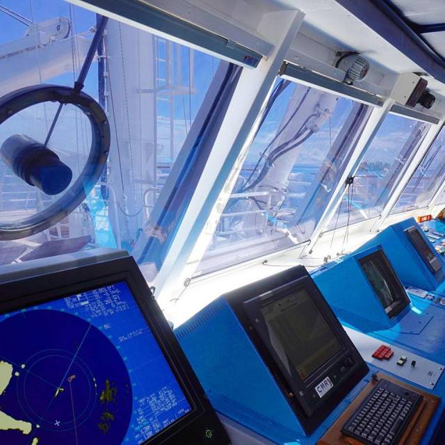 Guests of the high-end luxury operated Star Pride have an opportunity to visit the wheelhouse to examine navigation charts with the Captain, which is Windstar Cruises Open Bridge Policy. Afloat adds the above bridge is from either of the sail-assisted sisters, Wind Star and Wind Spirit.