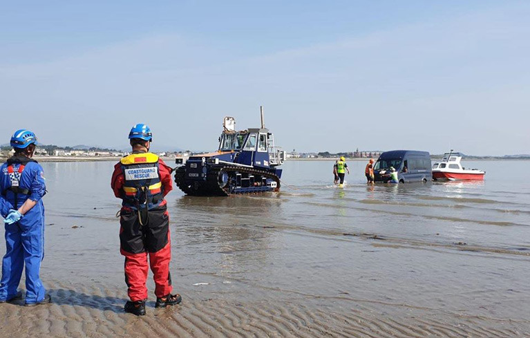 Newcastle RNLI tractor assisted the vehicle, which had become bogged in soft sand
