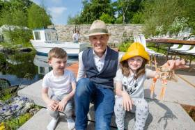 Georgie Stephens (5), garden designer Andrew Christopher Dunne and Louise Stephens (8) are pictured at the Sustainable Seafood Garden supported by Bord Iascaigh Mhara (BIM) at this year's Bloom in the Park