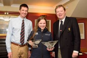 Erin Mcilwaine, winner overall and first girl of the Topper Winter Championships at Royal Cork. Erin is photographed with Pat Horgan Class Captain Toppers RCYC (left) and Admiral John Roche who presented the prizes. Scroll down for photo galler