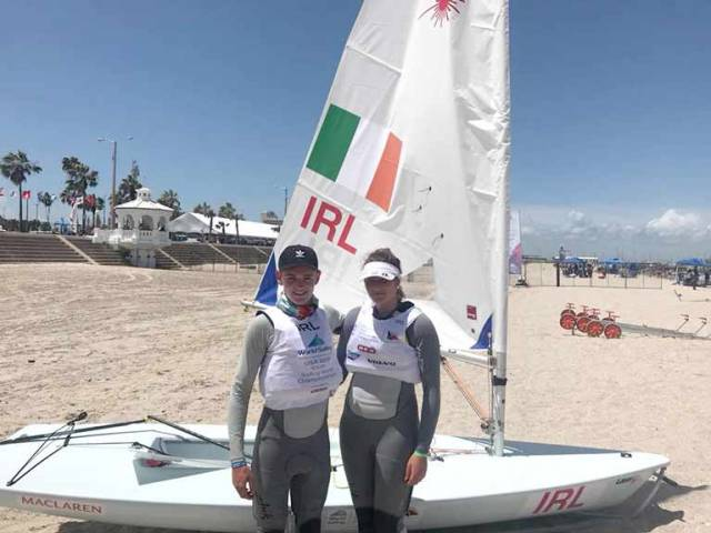 Jack Fahy (left) of Lough Derg and the Royal St. George Yacht Club and Nell Staunton of the National Yacht Club on the beach in Corpus Christi