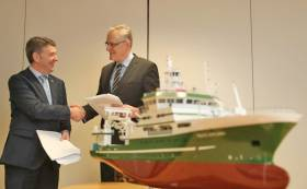 Marine Institute chief executive Dr Peter Heffernan shakes hands with Hans Ove Holmoey, managing director of Skipsteknisk AS, at the signing of the design contract for Ireland's latest marine research vessel