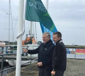 Irish Sailing President Jack Roy (left) raises the IS Training Centre flag at KIlrush Marina watched by Training Centre Principal and Marina Manager Simon McGibney
