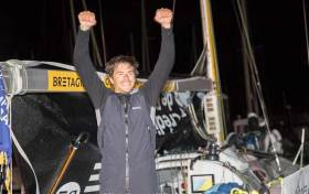 Sebastien Simon (Team Brittany Cmb) raises his arms in victory at the end of the second stage