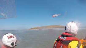 Rescue 116 dropping an additional salvage pump on Colt Island
