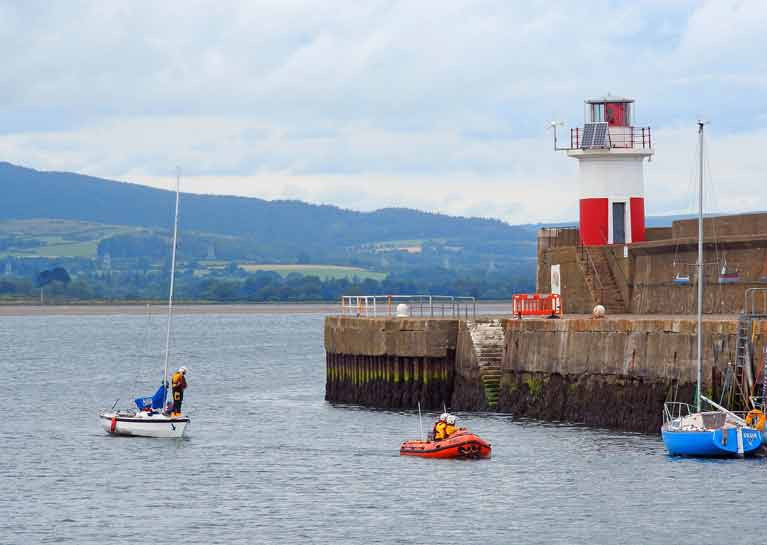 A towline was established and the yacht with two sailors was brought safely alongside the East pier at Wicklow harbour