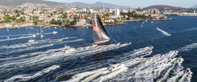 Wild Oats X1 approaching the finish in the heart of Hobart harbour to take line honours in the Rolex Sydney-Hobart Race 2018. Thanks to her speed, though the actual wind is from aft of the beam, she seems to be on a close reach