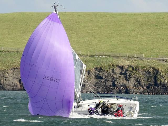 A competitor broaches in a breezy outing on the Shannon Estuary yesterday. Scroll down for more photos below
