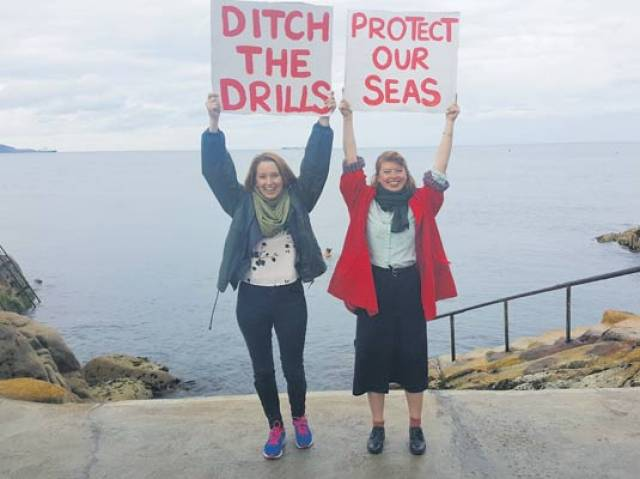 Kish Bank Oil Prospect: Green Party representatives Una Power and Sinead Mercier protesting in the Forty Foot, Sandycove on south Dublin Bay. Dalkey is another coastal suburb where Dublin Bay meets Killiney Bay.