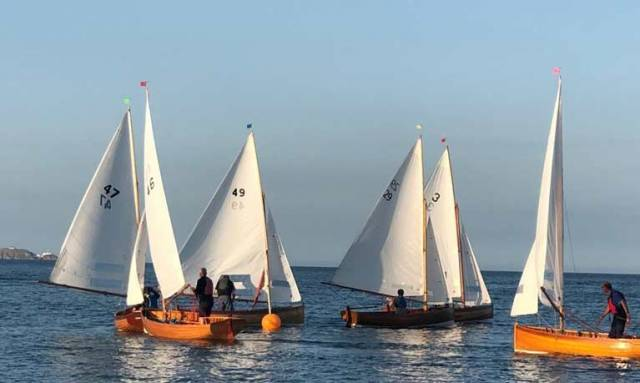 Tight racing at a leeward mark