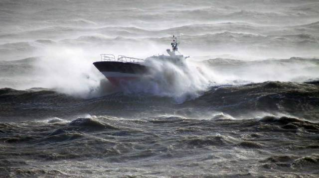 Rising Sea Levels: A pilot cutter in rough seas off the Irish coast which have risen 7cms alone since early 1990's. The next 5-15 years are critical to act if we are to stop 'permanent' damage to the planet