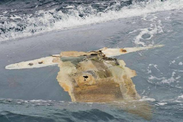 Photograph of the Cheeki Rafiki's upturned hull taken by crew of USS Oscar Austin on 23 May 2014