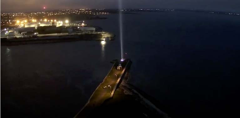 An aerial view of the beam, and of the illuminated port and city, was filmed by Electric Skyline (see vid below)