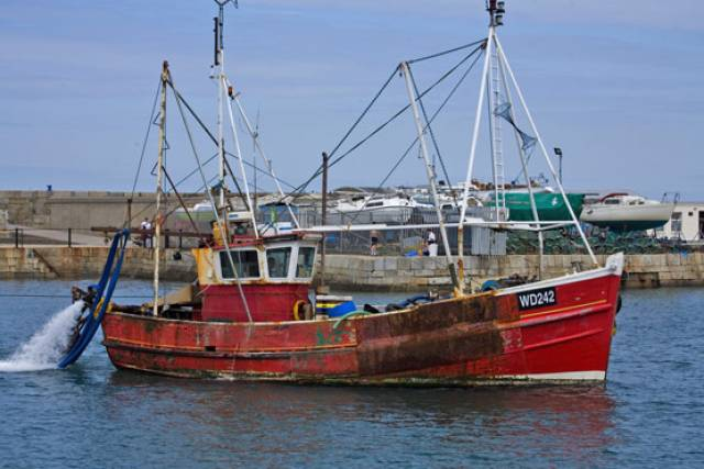 A fishing boat in Howth on the Irish Sea, where many Irish trawlers fish within British territory