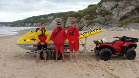 L-R RNLI Lifeguards, Bosco McAuley, Ali Boyd and Stephen Parish pictured yesterday in front of the RNLI Rescue Water Craft following the rescue at Whiterocks